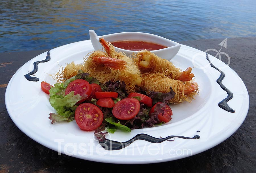 Shrimps wrapped in kadayifi filo and a sweet–sour sauce