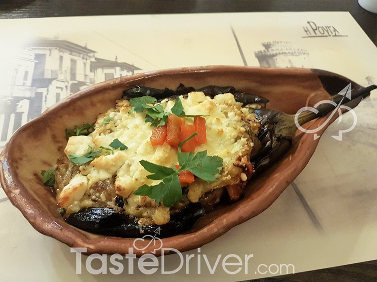 Baked eggplants with a feta (cheese) slice on the earthenware