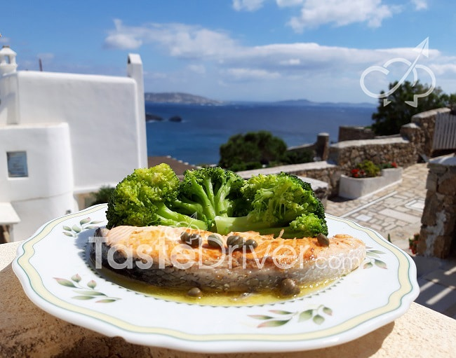 Fresh salmon with tsipouro sauce and capers