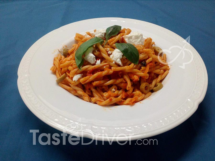 Twisters with tomato, olives, capers and feta cream